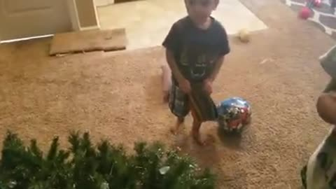 Kid gets upset when mom takes down the Christmas tree