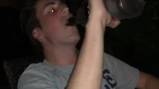 Guy finishes an entire bottle of alcohol clear  - Video