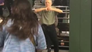 Zoom in on old man green shirt dancing in subway - Video