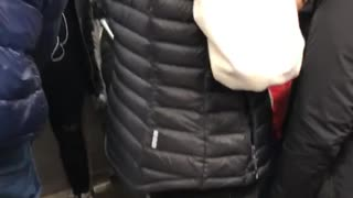 Red astronaut space suit on subway  - Video