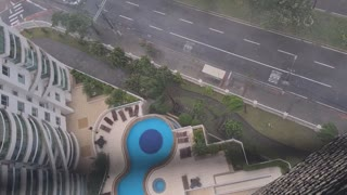Storm Pushes Water Tank from 24-Story Building