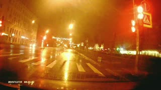 Car Flies Through Traffic Light