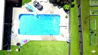 Man in Birthday Suit Jumps into Swimming Pool on a Sunny Day