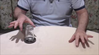 A Coin Strangely Enters An Upturned Glass  - Video