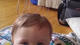 Baby has mind blown by scalp massager - Video