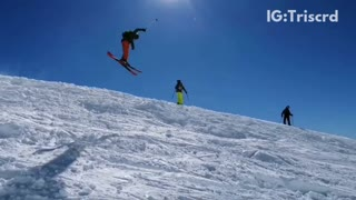 Skier does backflip over hill and lands sideways into snow