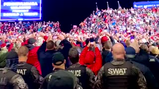 Trump crowd chants USA while swat team takes snaps