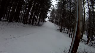 Snowboarding behind the school