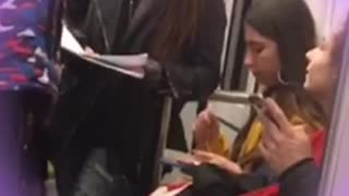 Girl yellow jacket eating pasta out of tupperware on subway
