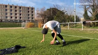 Beanie guy does front roll on grass soccer field  - Video