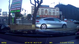 Motorcycle Rips Bumper Off Car - Video