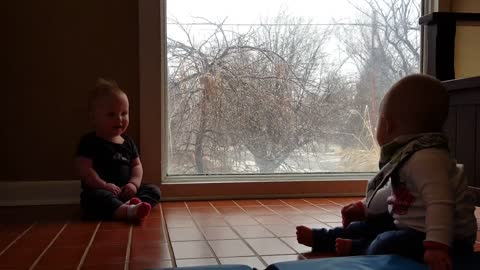 Snowfall sends twins into giggle fit