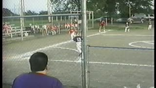 Young Softball Pitcher Tackles Runner To Stop Her From Scoring
