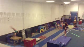 Gymnastics girl in white shirt misses red jumping block face plant