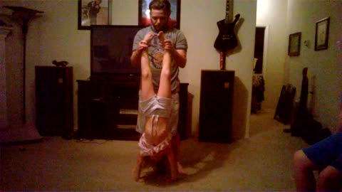 Working Out With Daddy (Handstand Pushups)
