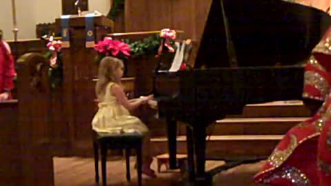 Big Brother Gives Encouragement At First Piano Recital (Silent Night)