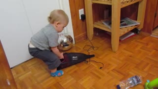Baby Plays With Dustbuster, Freaks Out When It Turns On - Video