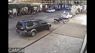 Distracted Motorcyclist Rear-Ends Car - Video