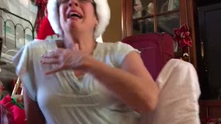 First-time grandma can't hold back her excitement - Video