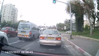 Crazy biker has close call with turning car - Video