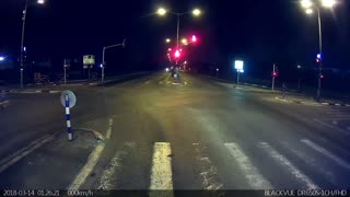 Extreme close call with driver plowing through red light  - Video