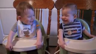 Twin Boys Crack Each Other Up During Dinner - Video