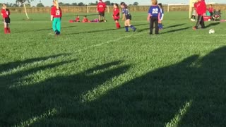 Girl Accidentally Kicks Soccer Ball into Girls Face
