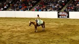 Horse and rider race into the arena, show the crowd what it means to be 'a lady' - Video