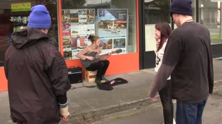 Girl Busker gets her guitar broken  - Video