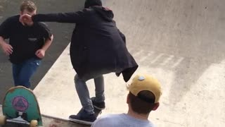 Black jacket kid glasses drops in halfpipe skateboard falls  - Video