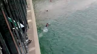 Boy jump from too much height in water  - Video