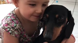 Little Girl Loves Her Puppy