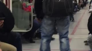 Man hover boards through subway - Video