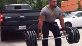 Man Pulls Truck While Lifting 415lbs - Video