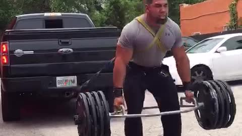 Man Pulls Truck While Lifting 415lbs