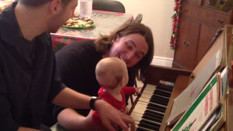 baby is mesmerized by piano playing
