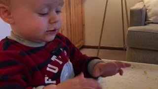 Little kid black and red striped shirt playing games on phone - Video