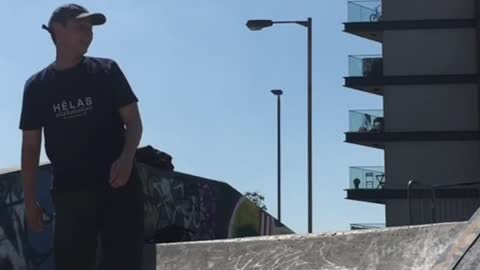 Guy skateboard up half pipe hits stomach on top of ramp