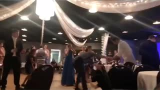 Guy fails dirty dancing jump on woman at wedding - Video
