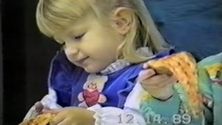 Little Girl Struggles With An Uncooperative Slice Of Pizza