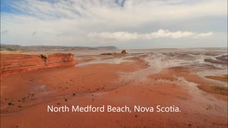 Red sand, blue skies, and white clouds - Video
