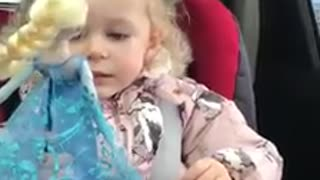 Toddler Delivers Hilarious Facial Expressions While Singing 'Let It Go' In The Car - Video