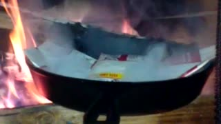 Family Tries To Cook Microwave Popcorn In The Fireplace - Video