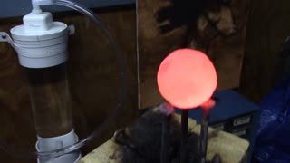 Red hot nickel ball vs Legos - Video