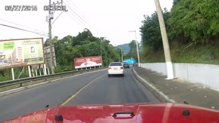 Swerving Truck Nearly Misses Approaching Car - Video