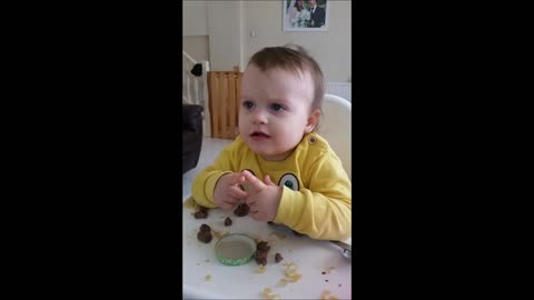 Baby perfects her table manners