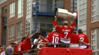 Victorious Blackhawks parade through Chicago