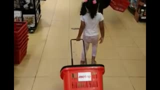 Toddler doing grocery shopping