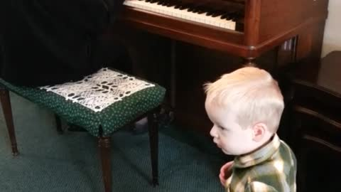 Grandson Dancing To Grandma Playing Piano