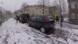 Police offices participates in playful snowball fight - Video